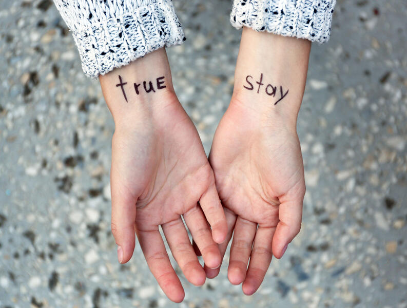 hands young woman tattooed words on shutterstock 342560561